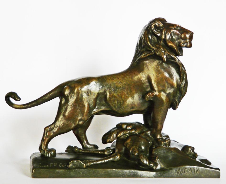 Cain lion autruche bronze